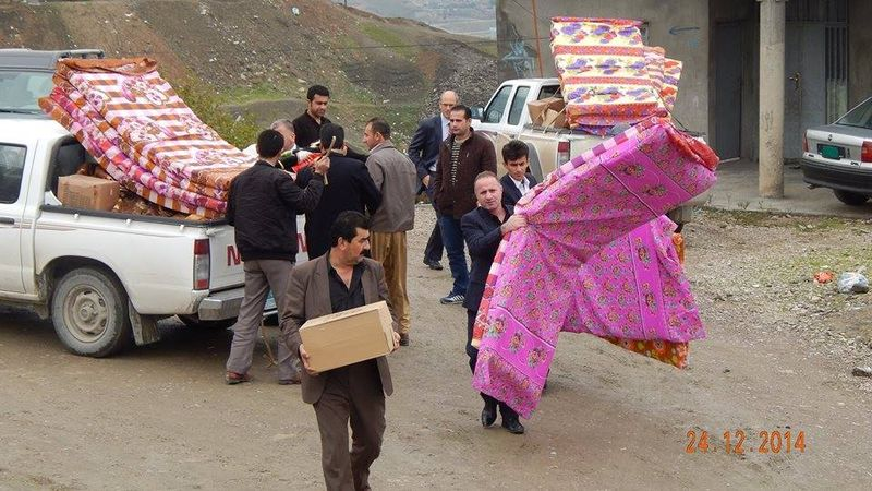 Distributing aid to War Widow families
